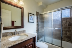 Shared bathroom downstairs, shower/tub combination