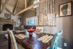 Cozy dining/living combination with gas fireplace for the perfect gathering spot
