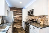 Completely new kitchen, all new appliances, with mountain cabin backdrop